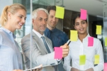 Business team looking at sticky notes