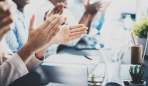Closeup photo of partners clapping hands after business seminar. Professional